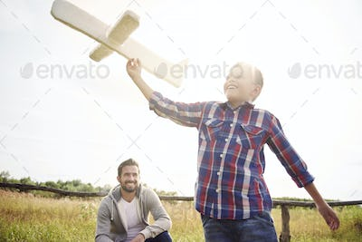 Father and son have fun during the playing
