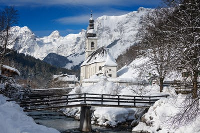 Ramsau church with Alps mountains in the snow in winter