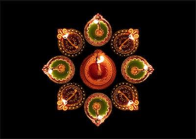 Happy Diwali. Diya oil lamps against dark background,