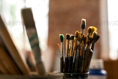 Group of various paintbrushes for professional painting on workplace of artist