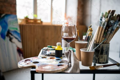 Workplace of contemporary professional painter inside studio of arts