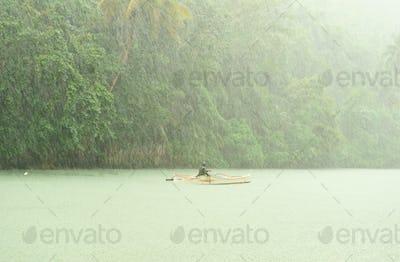 Tropical rain above river