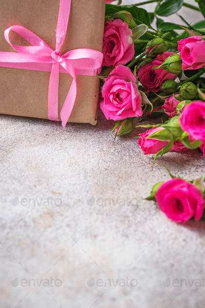 Pink roses and gift boxes with ribbons