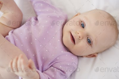 Cute newborn lying down on the bed
