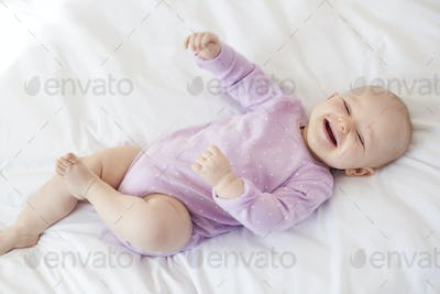 Sweet little girl on the bed