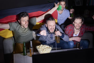 Males watching championship on TV