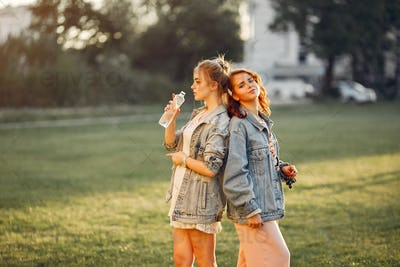 Elegant and stylish girls in a summer park