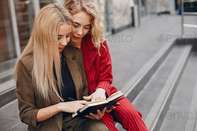 Two businesswomen working in a city
