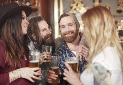 Group of best friends meeting in the pub