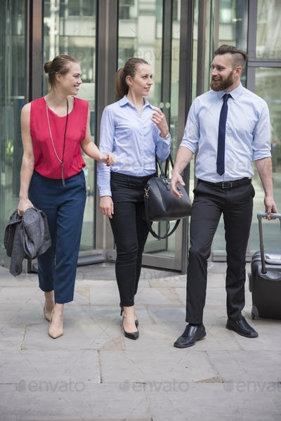 Group of business people leaving office building