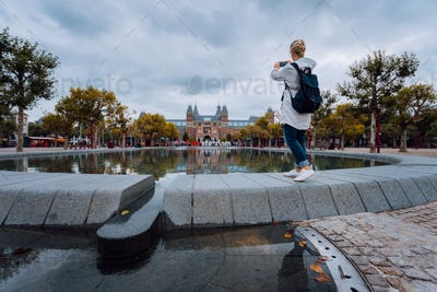 Woman tourist visiting Amsterdam. Travel in Europe city trip concept