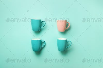 Pattern from blue cups over blue background. Birthday party celebration, baby shower concept. Punchy