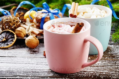 Christmas background of two mugs of hot chocolate with marshmall