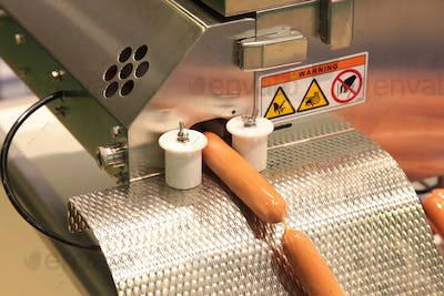 machine for packing sausages into a shell