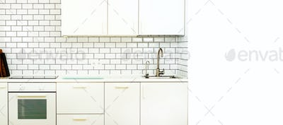 White interior design, modern and minimalist style kitchen with household appliances. Open space in