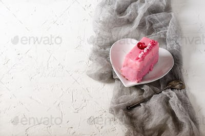Pink cupcakes, spoon under morning sun on grey runner and white background