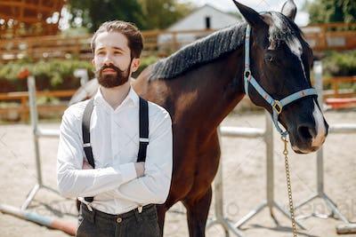 Handsme man standing in a ranch