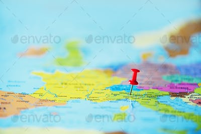 Red pushpin, thumbtack, pin showing the location, travel destination point on map. Copy space