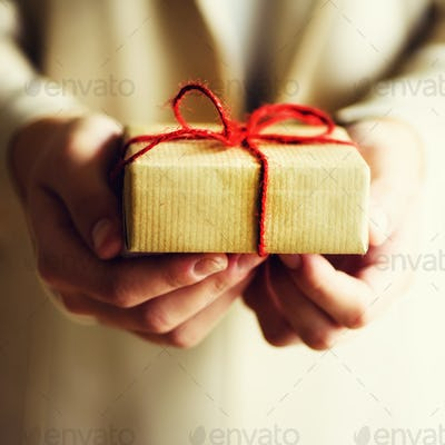 Female hands holding gift box, copy space. Christmas, hew year, birthday, valentines day concept