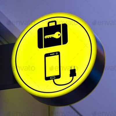 Charging mobile, cellphone battery icon in public area, airport. Locker luggage sign. Copy space