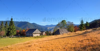 Beautiful landscape with old wooden huts in the Carpathians moun
