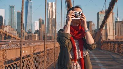 Young woman on the Brooklyn Bridge in NYC