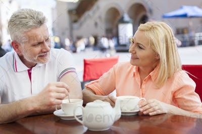 Couple have meeting at cafe outdoors