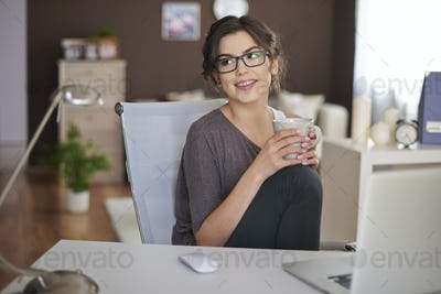 Relaxing with laptop and cup of coffee