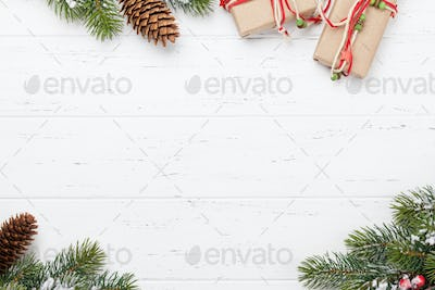 Christmas card with gift boxes and fir tree branch