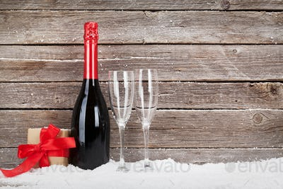 Christmas card with champagne and gift box