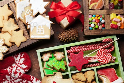 Christmas greeting card with gingerbread cookies and sweets