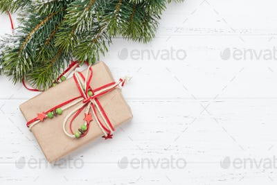 Christmas greeting card with gift box and fir tree