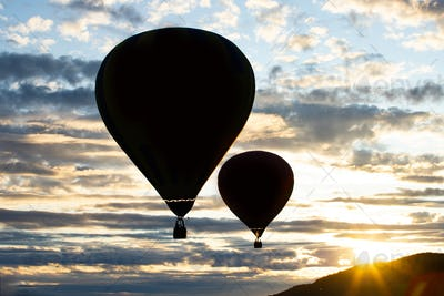 Hot air balloon over blue sky.