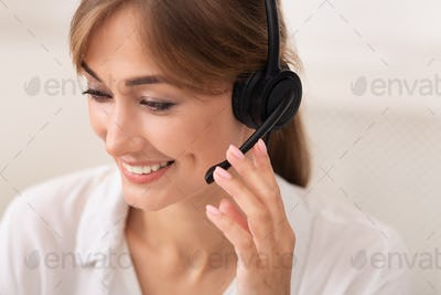 Positive Lady In Headset Working In Call Center, White Background