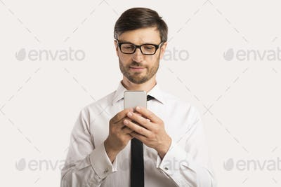 Businessman Using Smartphone Standing Over White Background