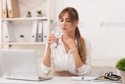 Lady Having Sore Throat Holding Water Glass Working In Office