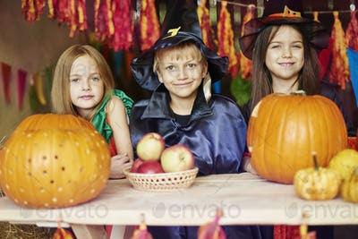 Portrait of cheerful children in the shed
