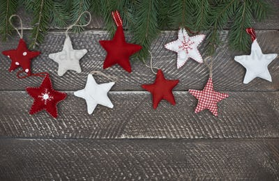 Colorful stars on the wooden background