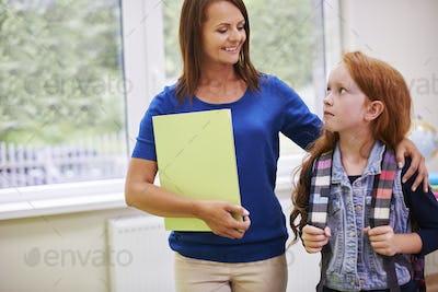 Elementary student talking to her teacher