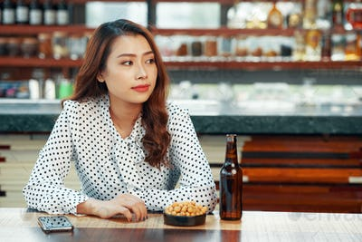Pretty woman waiting in bar