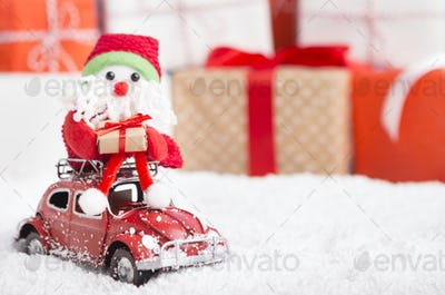 New year Santa delivering presents by car on background
