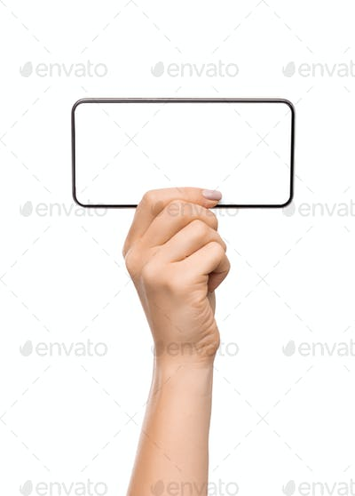 Woman demonstrating blank smartphone screen in horizontal orientation