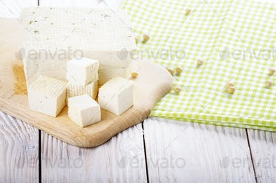 Soy Bean curd tofu on cutting board Non-dairy alternative substi