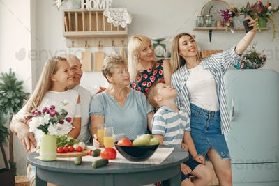 Beautiful big family prepare food in a kitchen