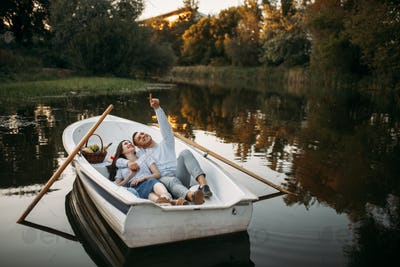 Love couple lying in a boat and dreaming