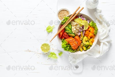 Buddha lunch bowl with grilled salmon fish, rice, fresh vegetable and lettuce salad, healthy eating