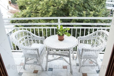 Terrace with Wicker Furniture and a View of the Treetop