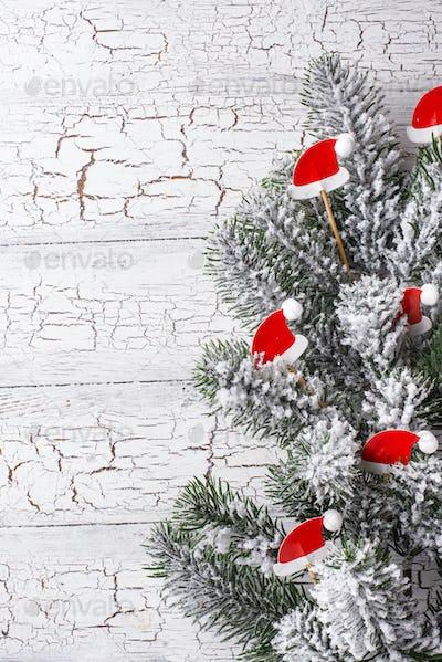 Christmas background with decorative Santa hats