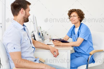 Young Woman Speaking to Patient