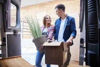 Joyful Young Couple Moving In